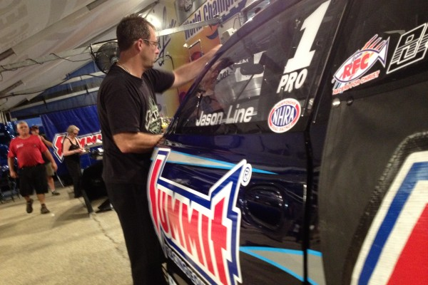 Anderson works on Line's car