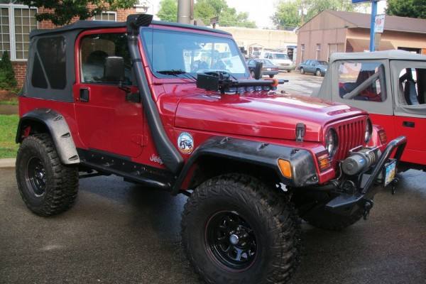 Red Jeep Wrangler with snorkel