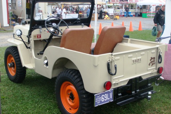 Classic Willys Jeep with orange wheels