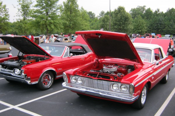 Red Plymouth Fury and Cutlass