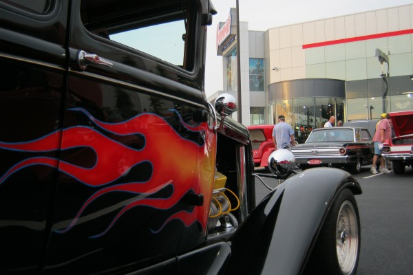 Black street rod with flame decal