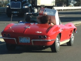 Wife carrying headers in classic Corvette