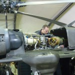 Jason Line climbed up the Blackhawk's frame to peruse the main rotor's engine.