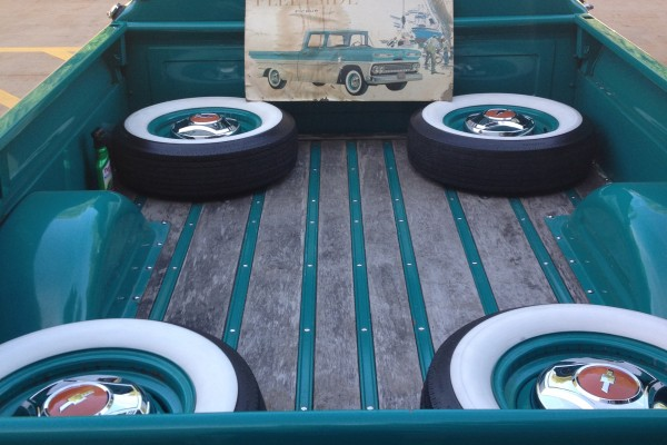 Classic Chevy pickup truck bed with white wall tires