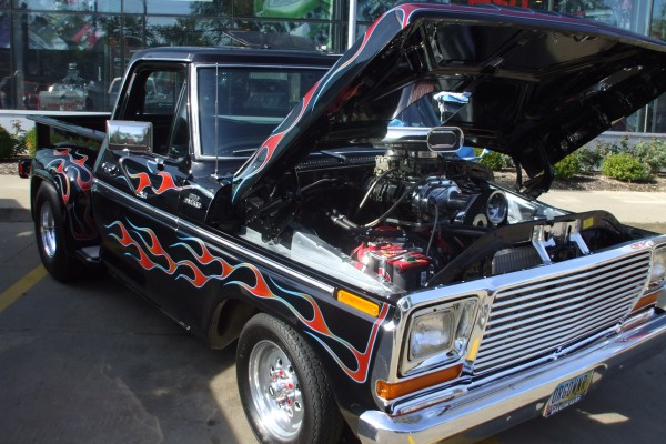 Classic blown black Chevy pickup with flames
