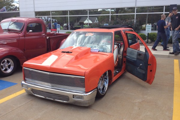 Lowered orange Blazer with suicide doors