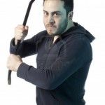 17377386-image-of-mad-man-holding-crow-bar-against-white-background