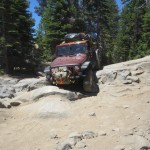 Dropping off a ledge on the Rubicon Trail, our heavily-loaded Jeep Rubicon Unlimited didn't scrape on the way down thanks to Daystar's 3-inch lift kit.