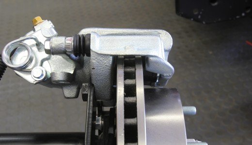 The calipers are specific left and right side units. Make sure they are correctly mounted with the bleed screw in the highest position. Otherwise you won't be able to properly bleed the system. Once you have installed the calipers, carefully inspect their position over the rotor. If the caliper is too close to the inboard side of the rotor, you may need to shim the caliper outboard