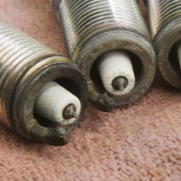 This is a close-up of a couple of spark plugs that indicated trouble in the cylinder. You can clearly see those black specs on the center electrodes, but perhaps what is more troubling is the fact that the ground electrodes are melted. The fix for this engine was less timing (which reduces heat in the chamber), a non-projected nose spark plug, and a higher octane fuel.