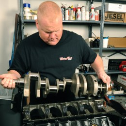 Trick Flow engine builder Todd Hodges lowers the Manley Pro Series crankshaft into the block. Forged from 4340 steel, the 4.250-inch stroke crank is heat-treated and nitride before being stress relieved, shot peened, and Magnafluxed. Other features include micro-polished .125-inch radius journals, gun-drilled mains, lightened rod journals for weight reduction, and fully profiled counterweights.