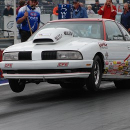 The truth is, pinion angle can move significantly and well tuned cars are setup to compensate. Look at how hard this well sorted Super Modified car is hitting the tire. It didn't get that way with a wayward pinion.