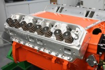 We had choice of either Edelbrock Performer RPM or Mopar Performance aluminum cylinder heads. Both feature 84cc combustion chambers, 210cc intake/70cc exhaust ports, 2.140 inch intake/1.810 inch exhaust valves, and valve springs that support up to .600 inch of valve lift. Since we only had time to dyno one set of heads, we opted for the Edelbrocks.  The heads were test fitted and checked for both piston-to-chamber quench and piston-to-valve clearance. Piston to quench (factoring in the MLS head gaskets) checked at 0.075 inch. Valve clearance was 0.250 inch intake and 0.270 inch exhaust.