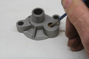 This is the oil filter adapter for a small- or big-block Chevy. It only takes slight pressure to open the valve which allows oil to bypass the filter and go directly to the engine.