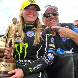 Brittany Force celebrates her first career NHRA Top Fuel win with father, and 16-time Funny Car champion John Force Sunday at the NHRA Gatornationals in Gainesville, FL. (Image/NHRA)