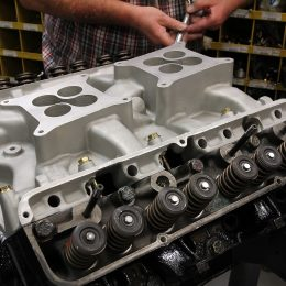 Another unique feature of Ford's FE engine family is the intake manifold actually forms part of the base for the valvetrain. The rocker arms cannot be bolted up, nor the pushrods dropped into place, before the intake manifold is installed. This is an original Ford dual quad aluminum intake for this engine.