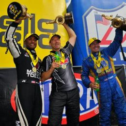 Antron Brown, Greg Anderson, and Ron Capps celebrate winning Monday's rain-delayed New England Nationals in Epping, N.H. (Image/NHRA)