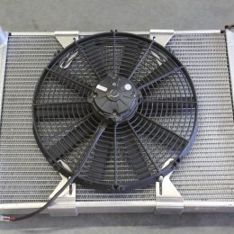 Here's a photo of a typical 16-inch fan mounted without a shroud on an aluminum radiator. You can easily see that the fan will only pull cool air through the portion of the radiator covered by the fan. If we install a fan shroud in between that covers the entire radiator, the fan will be able to pull cool air through the radiator's entire core. Simple, no?