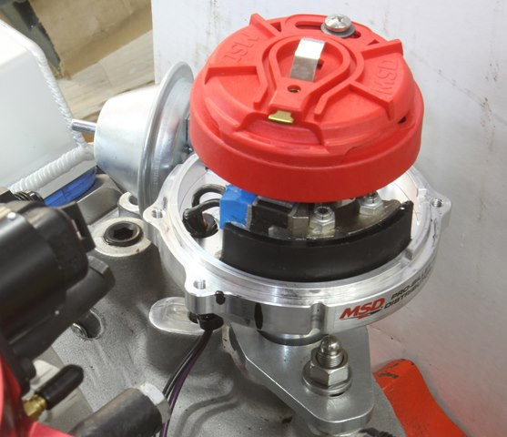 This is an adjustable rotor fitted to an MSD distributor. Note that we've positioned the rotor just before the black line on the distributor body. When the mechanical advance moves the rotor (roughly 21 degrees or 15 initial + 21 mechanical = 36 degrees BTDC), it will swing from before the terminal to after, which will be as close as we can get throughout the entire advance curve.