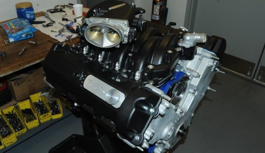 One 323 cubic inch 2V waiting for its turn on the dyno. The intake is a Trick Flow Track Heat EFI manifold. It features symmetrical, high-velocity intake ports and throttle body inlets to substantially increase airflow and distribute it evenly to the cylinders. The powerband is 3,500 to 8,000-plus RPM. The throttled body is a factory 4-Valve Cobra unit. The valve covers are Trick Flow cast aluminum.