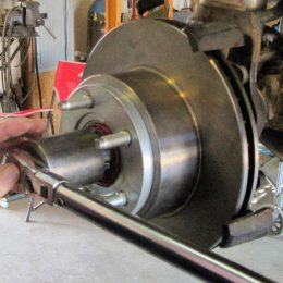 Use the proper spindle nut socket and torque the inner locking nut to 50-ft.-lb. After torqueing the nut, rotate the rotor in both directions to assist in seating the bearings, then loosen the nut a quarter-turn to release some pressure on the bearings.