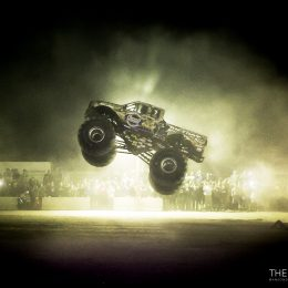 Dan Runte in the Summit Racing BIGFOOT 4x4 Monster Truck jump three full-size pickups before a large crowd of soldiers at Camp Buehring in Kuwait. Photo credit:  Anson Dionisio/Vectrus KBOSSS