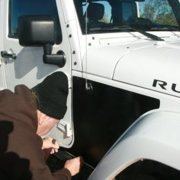 George laid out all the panels on the Jeep's hood until he could figure out where each panel went.