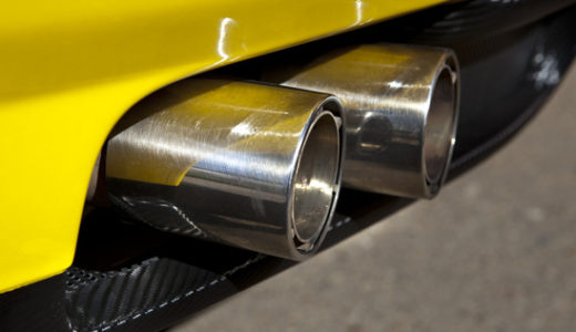Sports car exhaust pipe with two chromed tubes. Selective focus