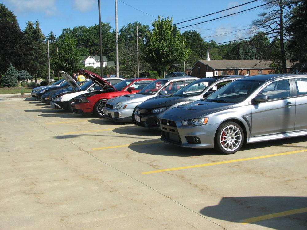 Row of Subuarus and Mitsubishis