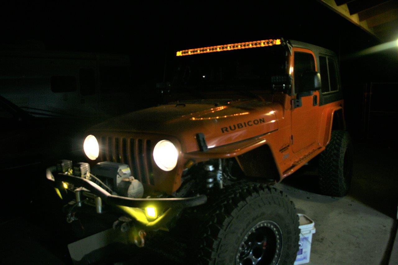 Installing Rigid Industries Auxiliary Led Lights On A Jeep Wrangler Additionally Light Bar Wiring Harness Kc Kit We Chose Amber Background Lighting For The Overhead Because Feel It Complements Orange Paint And Almost Appears When