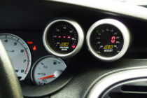 Here's an AEM wideband air/fuel UEGO guage and an AEM boost gauge installed in a Dodge Neon SRT-4 (Image/SRT Forums)