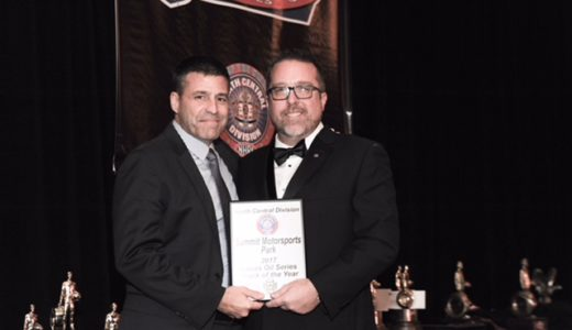 Bill Bader Jr. (left), president of Summit Motorsports Park in Norwalk, OH, accepts the Track of the Year Award for the eigth time from NHRA's North Central Division. (Image/SMP)