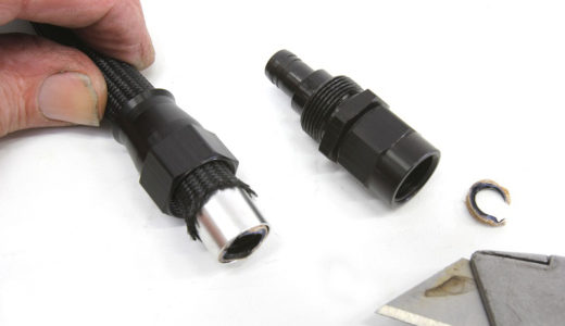 This is a pre-assembly photo of Holley's Ultra-Pro fuel line and its specific 90-degre hose end. Note that we've already installed the ferrule over the PTFE liner. The instructions say to use a sharp razor knife to trim a small portion of the liner flush with the ferrule and then install the fitting into the socket and tighten. (Image/Jeff Smith)