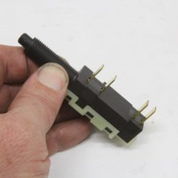 This is the four pole brake-light switch mentioned below. The lower connections are normally closed, which would route power to the 700-R4. When the brake pedal is depressed, the switch opens and power to the torque converter clutch is removed and disconnects from the input shaft. Simple and effective. (Image/Jeff Smith)