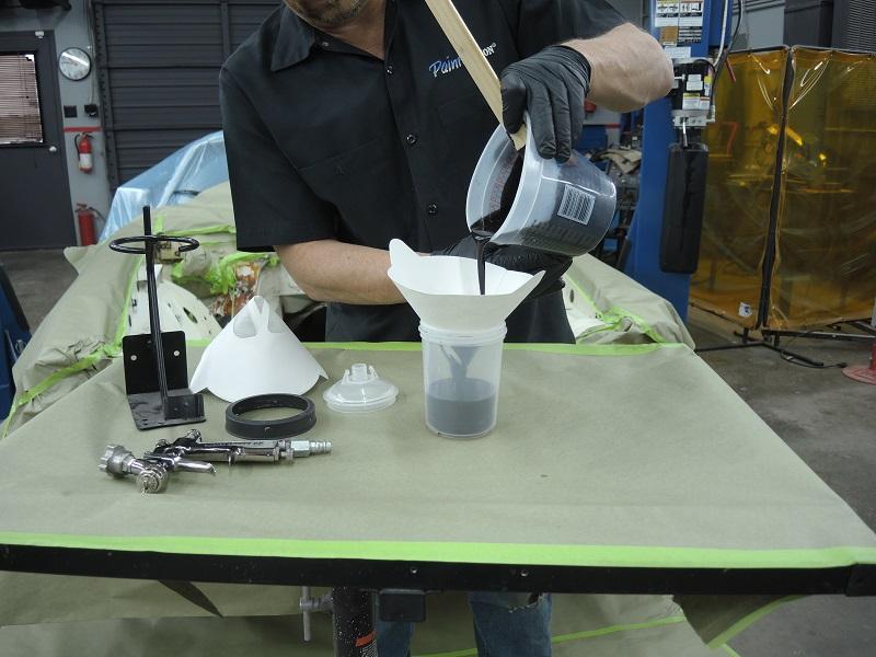 strain mixed primer into paint spray gun