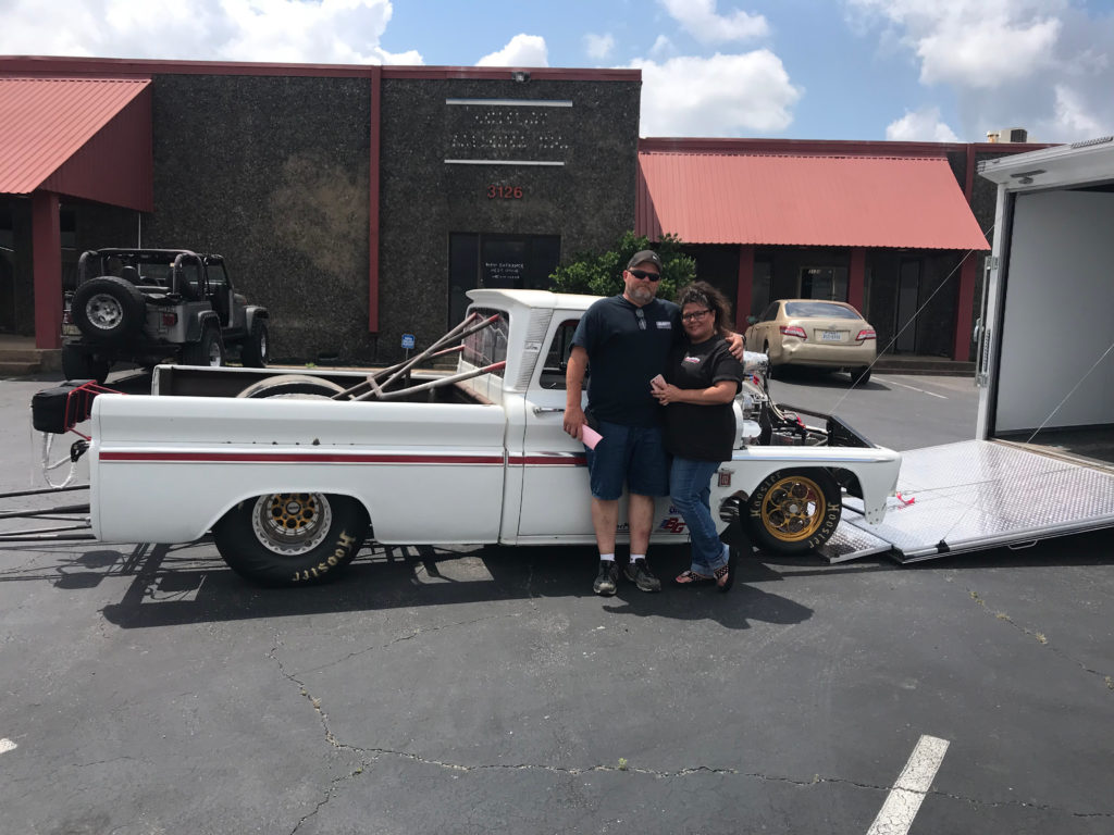 Eddie-and-Wife-with-Chevy-C10-on-Trailer