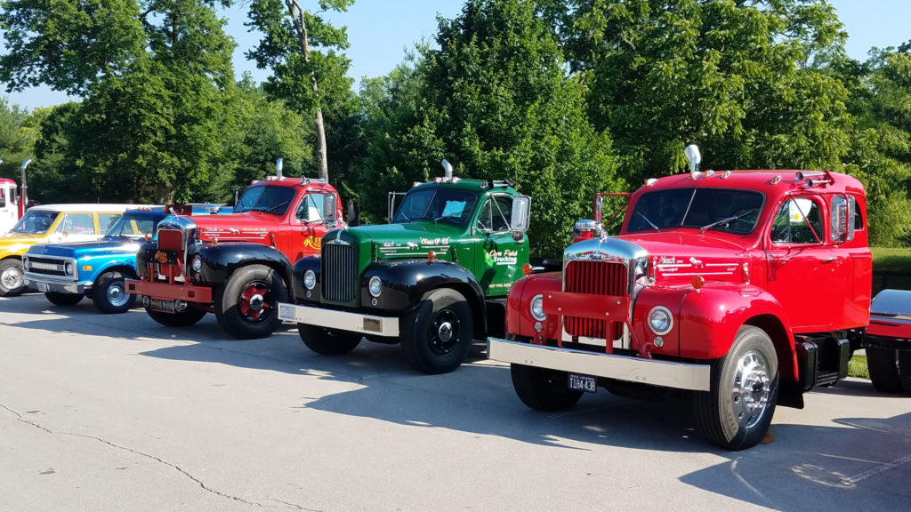 row-of-old-classic-vintage-trucks-at-car-show