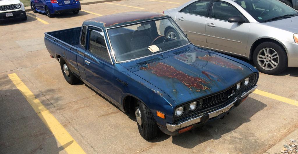 Datsun-620-pickup-truck-blue-passenger-side-hood-grille-detail
