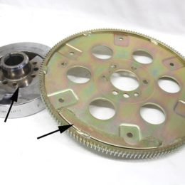 This photo illustrates the offset weight found on a flexplate and the harmonic balancer for an externally balanced big-block Chevy 454 as indicated by the arrows. On a flywheel, the offset weight is often a series of drilled holes around the outside of the flywheel instead of a fixed weight. (Image/Jeff Smith)