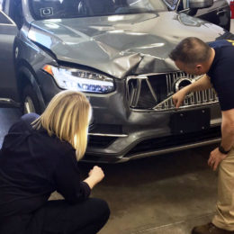 Investigators examine Uber's autonomous Volvo XC90 SUV that fatally struck a pedestrian in Tempe, AZ, earlier this year. (Image/National Transportation Safety Board via AP)