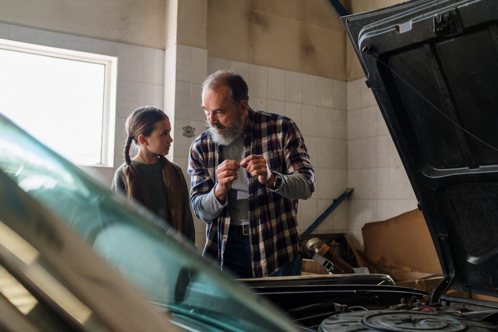 Father and daughter in the garage